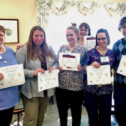 Staff members pose with awards at assisted living home in Windsor