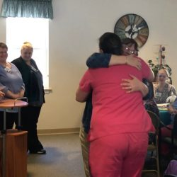 Shared hug at dementia care center in Vermont
