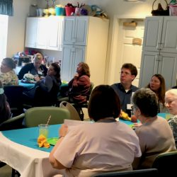 Staff listen at ceremony at assisted living home in Windsor