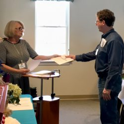 Man accepts award at nursing home in Windsor