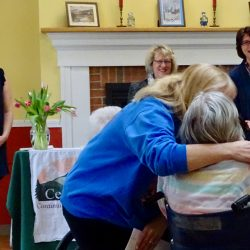 Resident at memory care facility in Vermont is given a hug