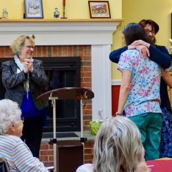 Employees hug at retirement home in Windsor