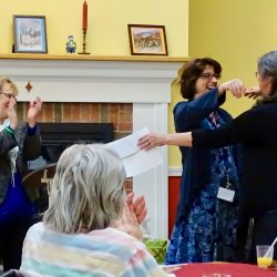Staff hugs each other at senior living community in Windsor