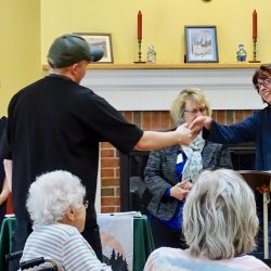 Shaking hands at dementia care facility in Vermont
