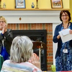 Leaders clap at award ceremony at assisted living center in Windsor