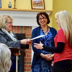 Smiling staff receives award at memory care facility in Vermont