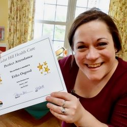 Staff holds up award at nursing home in Windsor