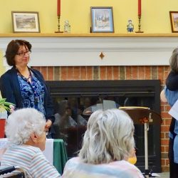 Hugging staff members at dementia care center in Vermont