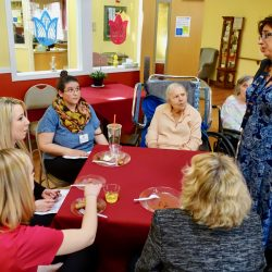 staff sit with residents at Alzheimer care center in Vermont