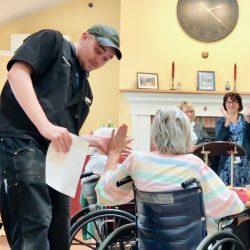 high-fives exchanged at assisted living in Windsor