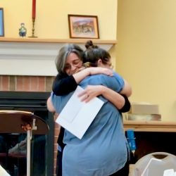 Barb Flinn gives Jen a big hug