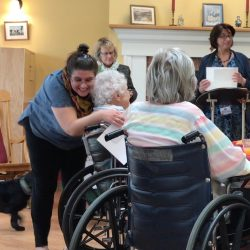 Staff hugs resident at memory care facility in Vermont