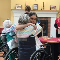 Hugs being given out at dementia care facility in Vermont