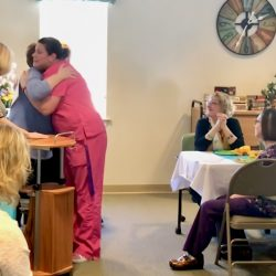 hugging staff at retirement home in Windsor