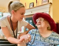 Staff welcomes new resident to nursing home in Windsor