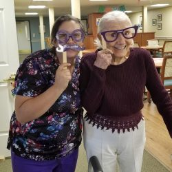 staff and resident of retirement community in Windsor celebrate