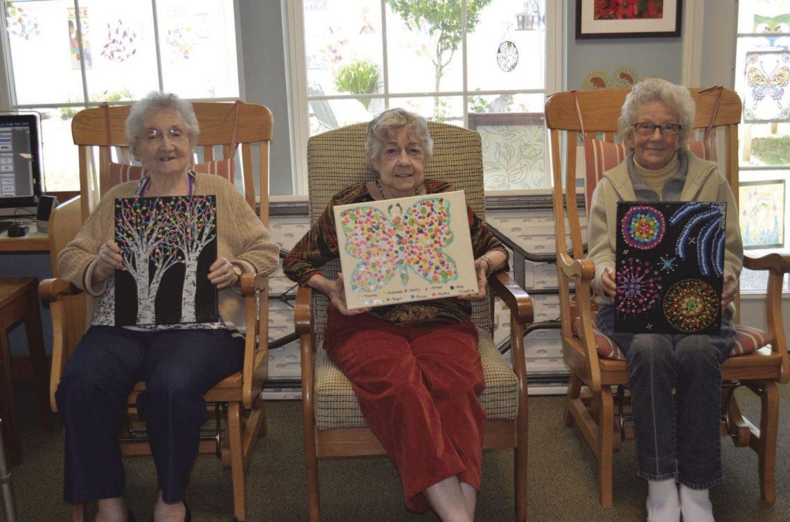 Virginia, Vera, and Claudine show off their artwork