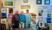 Windsor nursing home residents and staff pose together on artwork outing