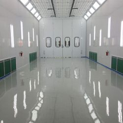Glossy white interior of spray booth