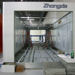 Open spray booth with ladders inside under construction