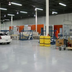 Speciality spray booth with white Chrysler limo outside of it