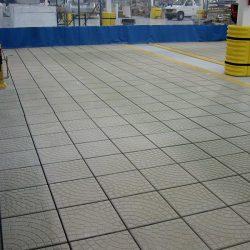 Textured flooring on inside of spray booth