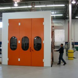 Specialty spray paint booth with orange doors