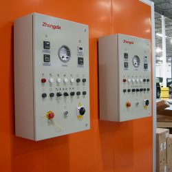 Two electrical boxes on orange spray booth