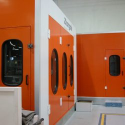 Orange and white spray booth with front window