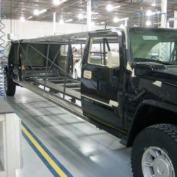 Black stretch Hummer limo with doors removed