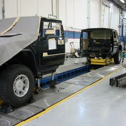 Black Hummer divided and preparing for paint job