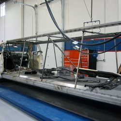 Frame of limo with body removed preparing for paint job