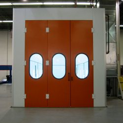 White spray booth with three orange doors closed
