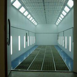 Front of spray booth with open doors metal grated floor