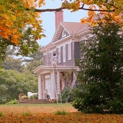 Fall foliage as one of our painters works on an exterior painting in South Carolina