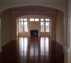 Neutral interior painting to match the hardwood floors of a South Carolina home