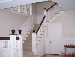 A white stairway with interior painting by Change My Paint