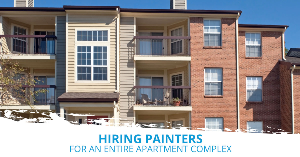 "A picture of white and brick apartment buildings with the words ""Hiring painters for an entire apartment complex"""