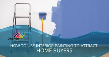 """The words """"how to use interior painting to attract home buyers"""" is overlaid on top of a picture of a white wall being painted a violet color."""