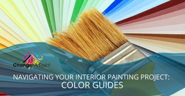 """A clean paint brush lays against fanned paint chips with the words """"Navigating your interior painting project: color guides"""""""