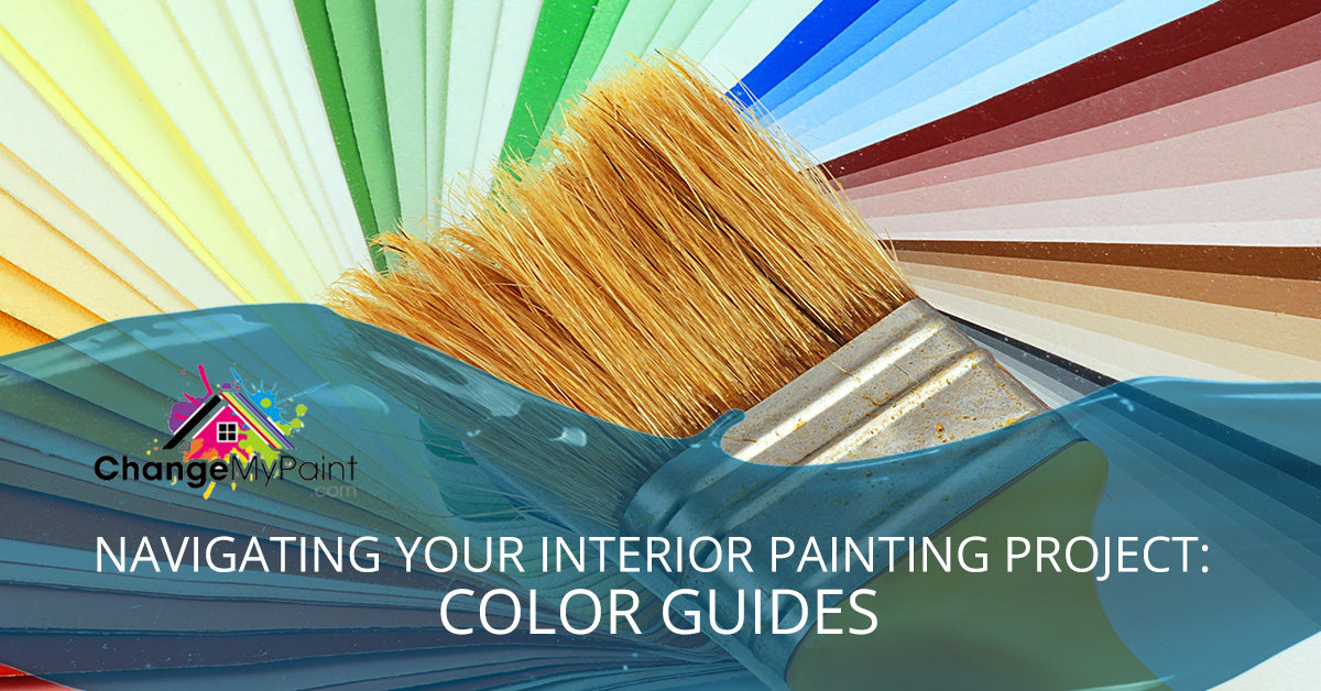 "A clean paint brush lays against fanned paint chips with the words ""Navigating your interior painting project: color guides"""