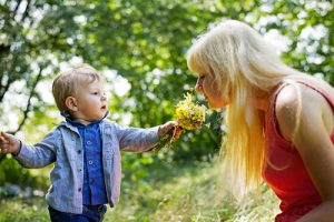 Child giving Mom flowers