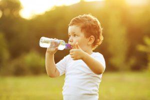 Child w water bottle