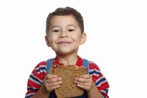child eating peanut butter