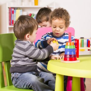 Toddlers sharing at daycare