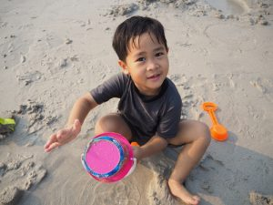 childs playing in sand