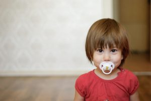 child with binky