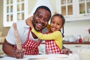 father cooking with daughter