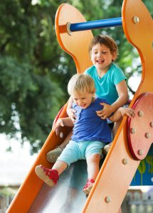 children on slide at playground