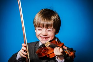 small child playing violin